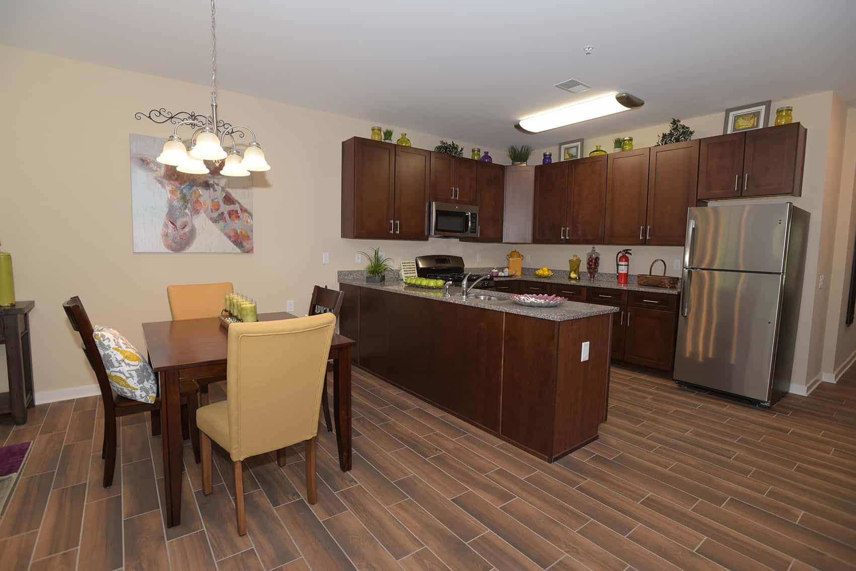 Kitchen and dining area with stainless steel appliances and wooden kitchen table