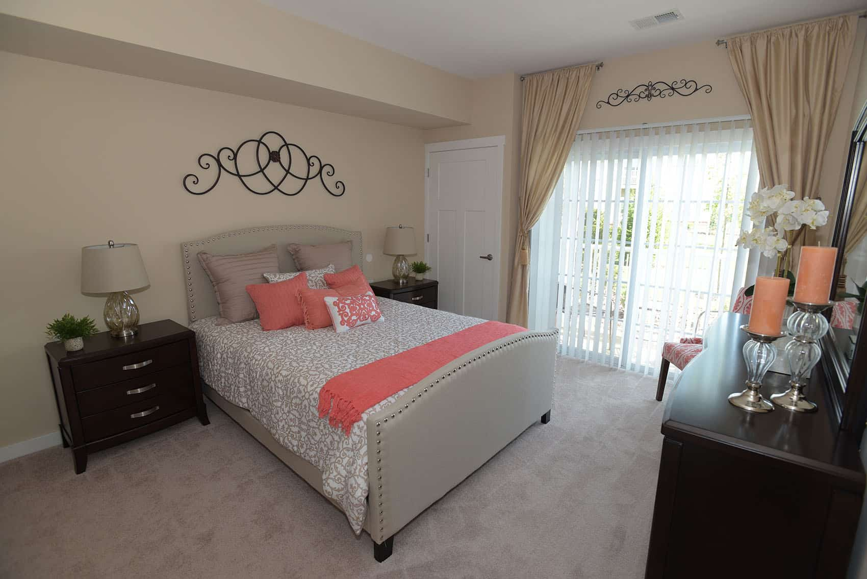 Master Bedroom with carpet flooring and bed with wooden nightstands