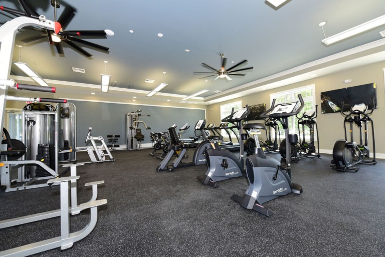 Fitness room with stationary cardio equipment and weights