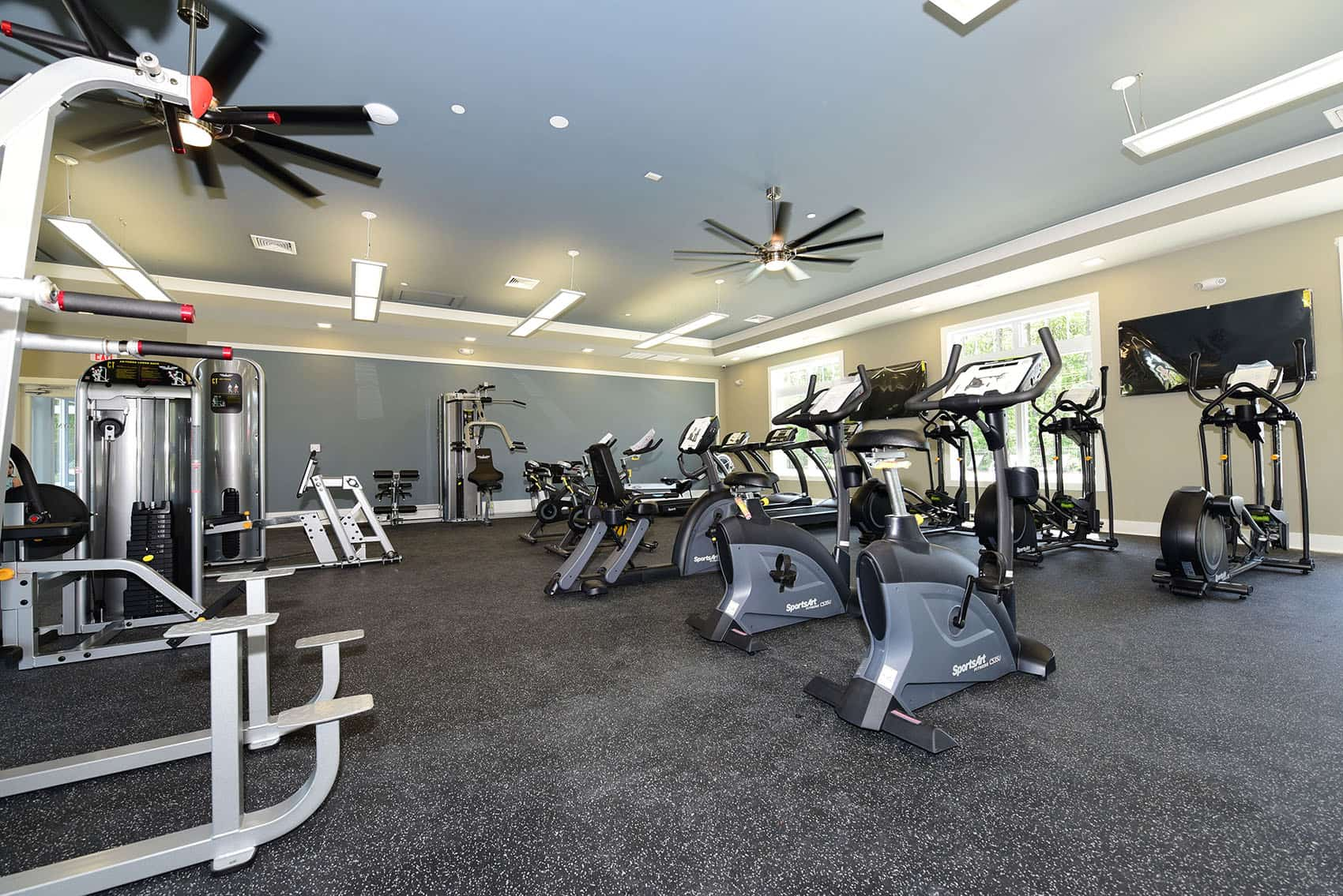 Gym area with weight machines and cardio equipment at Gardens at Jackson 21 apartments in Jackson, NJ