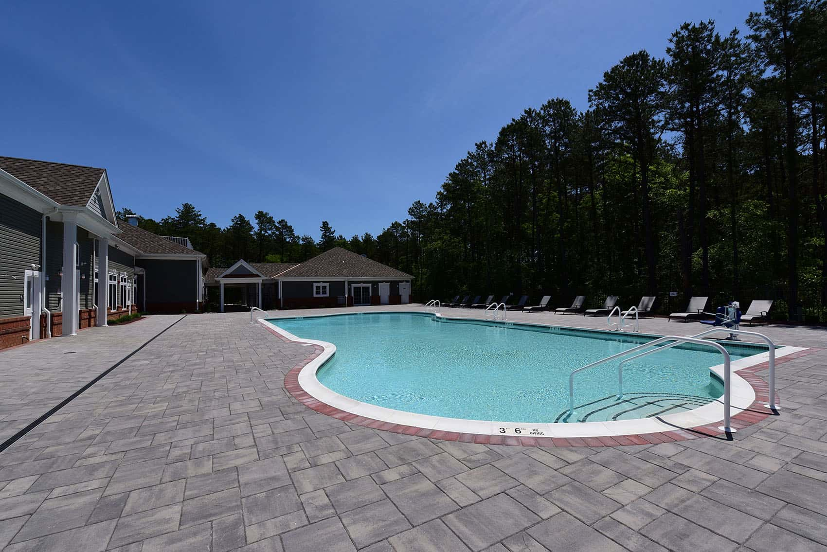 Sparkling pool and clubhouse at the Gardens at Jackson Twenty-One