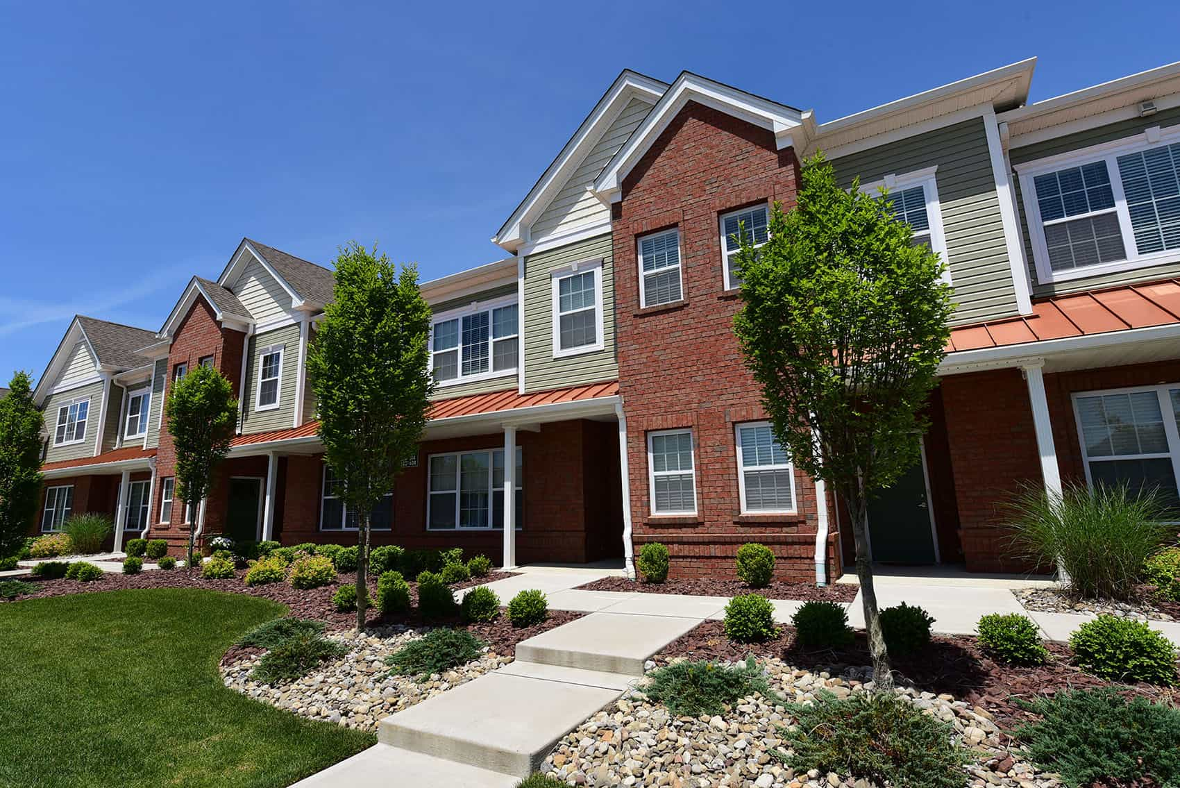 Exterior view of the Gardens at Jackson Twenty-One with beautiful landscaping and private entrances