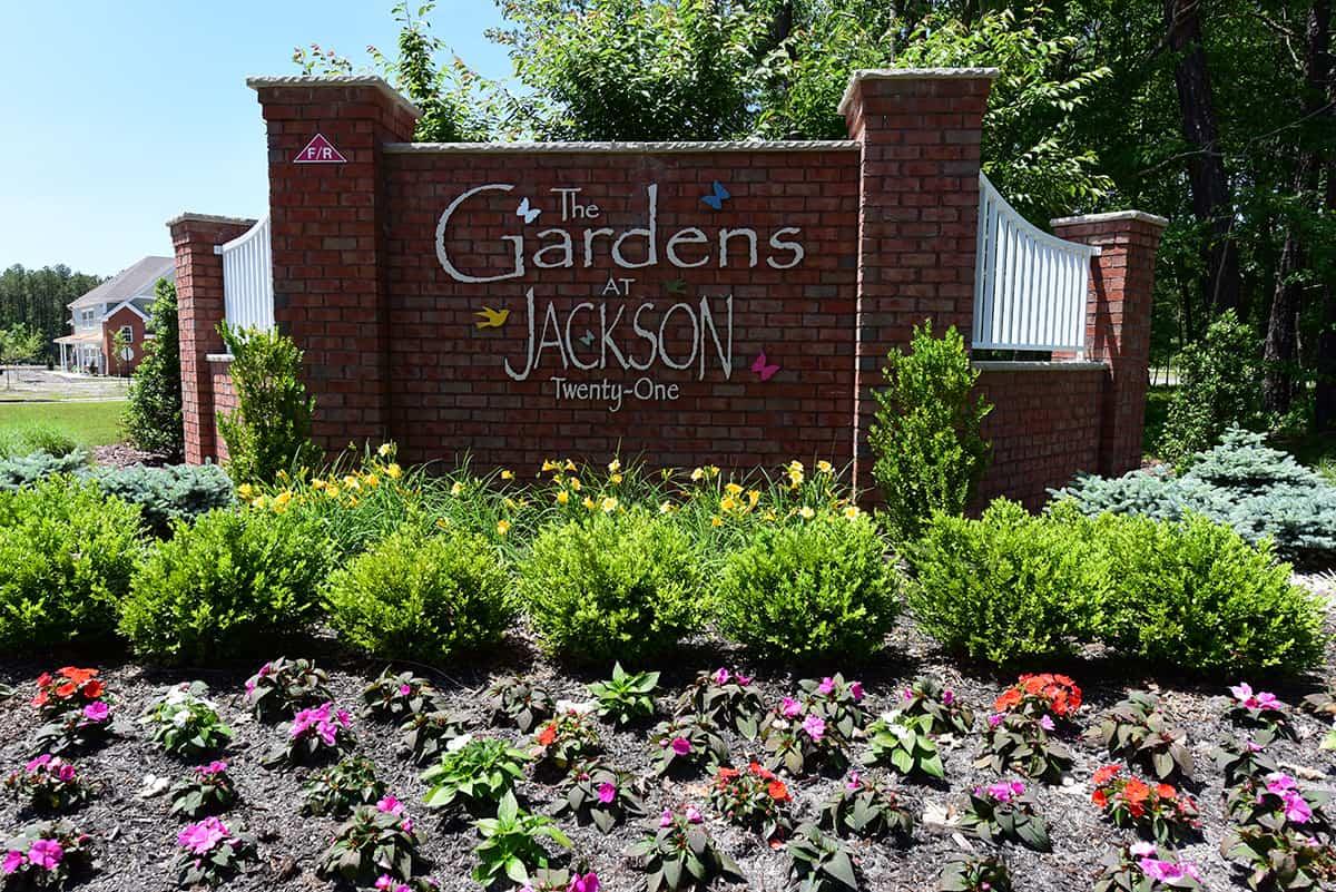 Brick entry sign to the Gardens at Jackson Twenty-One